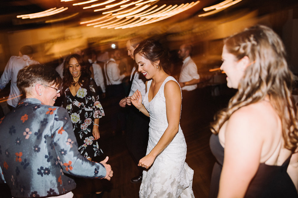 bride-and-mom-dancing-together-partying-candid-moments-toronto's-best-analog-documentary-wedding-photographers-candid-photography-london-ontario-wedding-inspiration.jpg