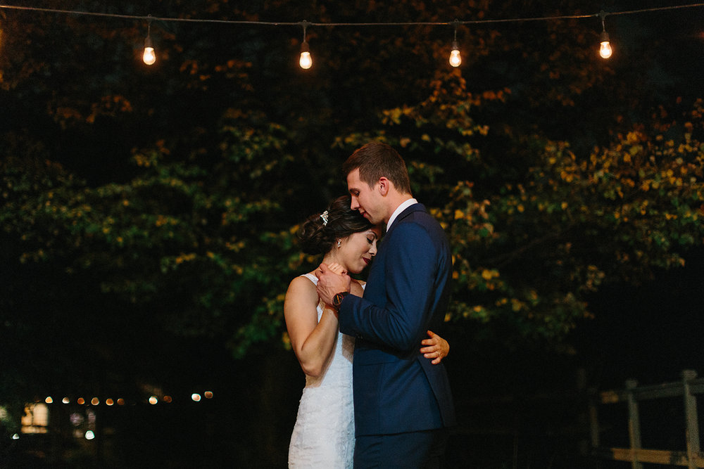 dancing-in-string-lights-outside-night-portraits-toronto's-best-analog-documentary-wedding-photographers-candid-photography-london-ontario-wedding-inspiration.jpg