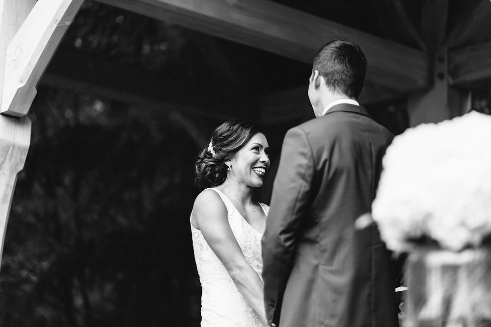 bw-bellamere-winery-ceremony-rustic-bride-saying-vows-cinematic-laughing-toronto's-best-wedding-photographers-candid-documentary-style-photography-london-ontario-winery-wedding-inspiration.jpg