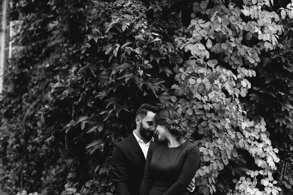 bw-toronto-restaurant-elopement-small-wedding-intimate-portraits-of-bride-in-purple-jumpsuit-old-ivy-buildings.jpg