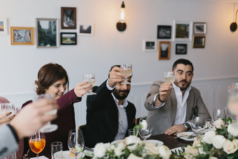 toronto-restaurant-elopement-intimate-wedding--bride-groom-guests-cheers-toast.jpg