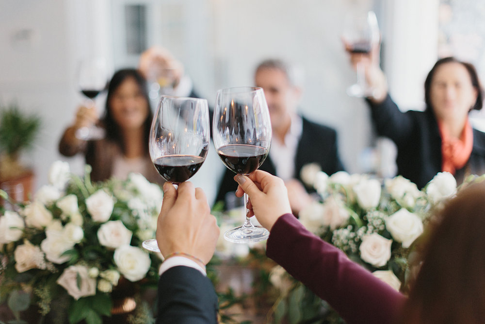 toronto-restaurant-elopement-intimate-wedding-guests-candid-moments-documentary-tablescape-florals-cheers-wine.jpg