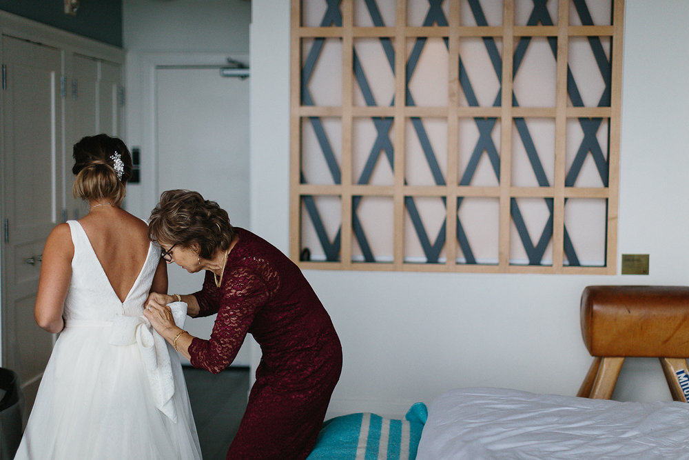 Prince-Edward-County-Drake-Hotel-Elopement-Ryanne-Hollies-Photography-Documentary-Details-of-Brides-wedding-dress-vintage-lace-boutique-junebug-weddings-best-of-the-best-wedding-inspiration-ideas-moments-candid.jpg
