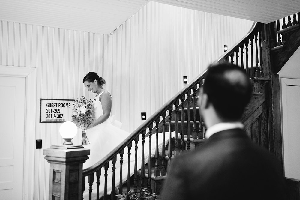 muskoka-wedding-photographer-toronto-wedding-photography-hidden-valley-resort-documentary-photojournalistic-getting-ready-groom-reading-card-from-wife-to-be.jpg