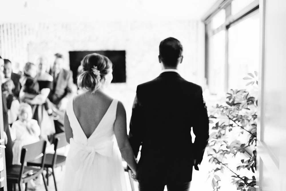 muskoka-wedding-photographer-toronto-wedding-photography-hidden-valley-resort-documentary-photojournalistic-fine-art-wedding-photography-lakeside-ceremony-cottage-country-bulldog-puppy-dog-walking-down-the-aisle-bw.jpg