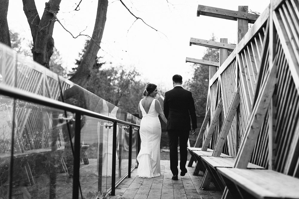 Prince-Edward-County-Wedding-Photographer-Drake-Devonshire-Elopement-Ryanne-Hollies-Photography-junebug-weddings-best-of-the-best-2018-bride-and-groom-portraits-artistic-walking-candid-moments-bw.jpg
