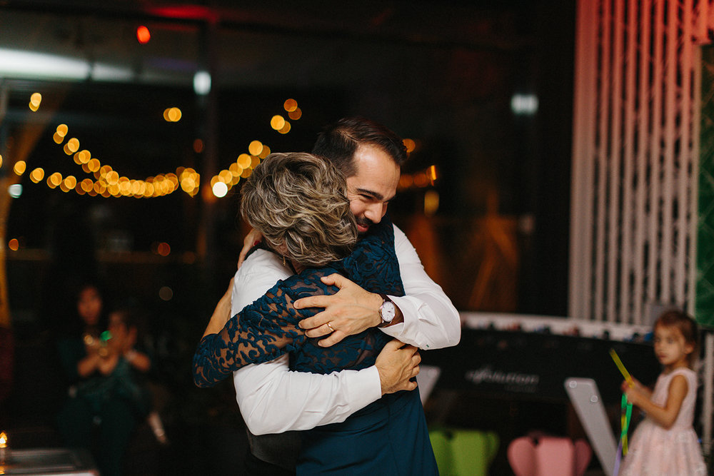 Prince-Edward-County-Wedding-Photographer-Drake-Devonshire-Elopement-Ryanne-Hollies-Photography-junebug-weddings-best-of-the-best-reception-glassbox-groom-and-mom-dancing-hugging.jpg
