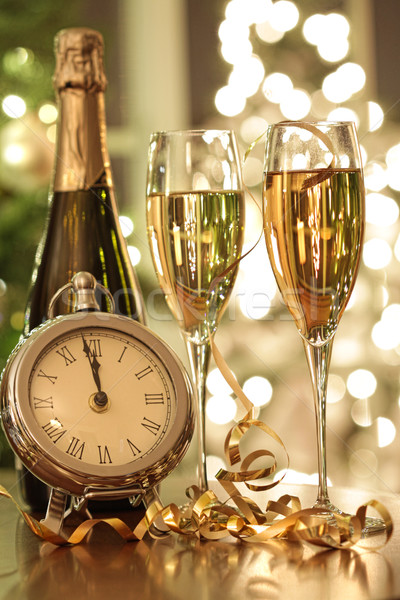 460723_stock-photo-champagne-glasses-ready-to-bring-in-the-new-year.jpg