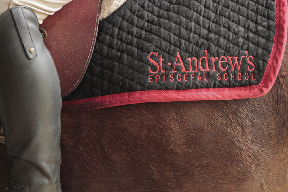 Barns provide the take, and you can switch the saddle pad to rep your school while you ride!