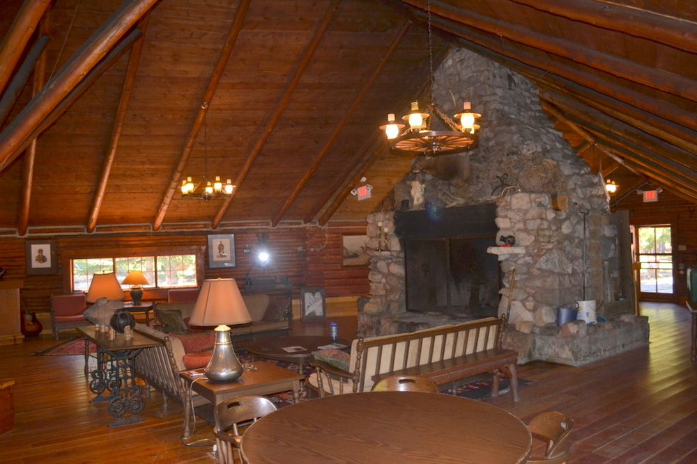 The interior of the main lodge features an impressive ceiling and large stone fireplace.