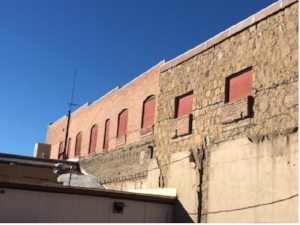 """From this picture you can see the original sandstone on the right of the image and the """"new"""" brick due to the fire on the left side."""