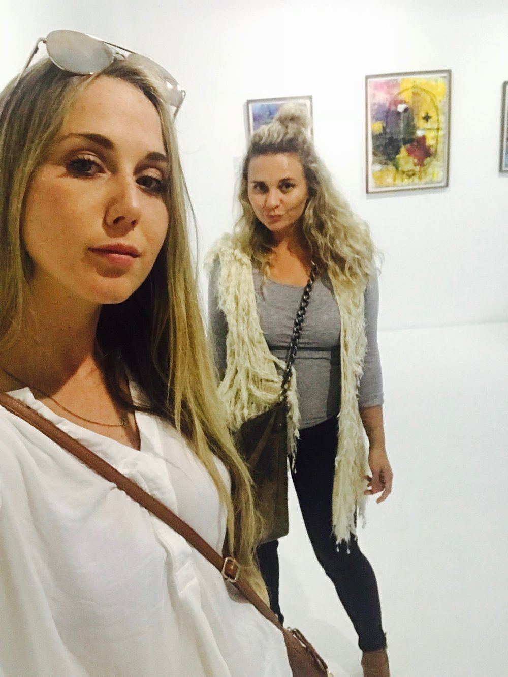 First thursday's in Cape Town, a vibing art walk and social scene. We are trying our best to be civilized in the art galleries.