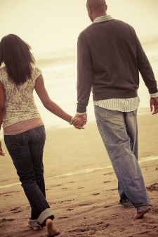 21-couple-walking-away-beach-holding-hands-sand23.jpg