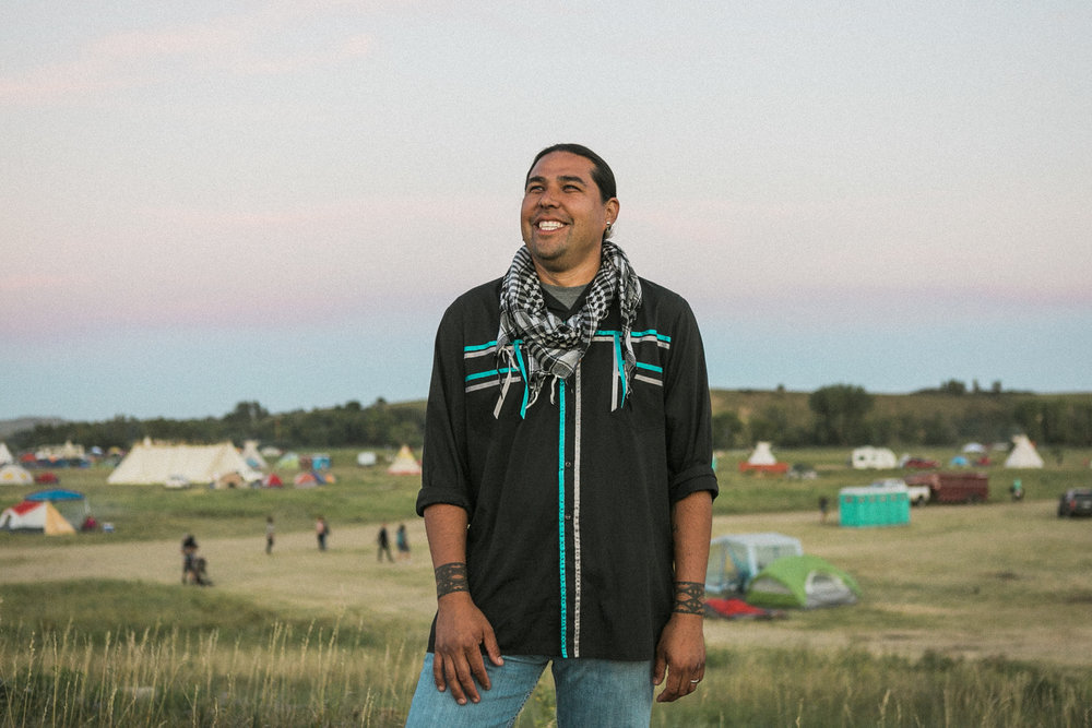 Dallas Goldtooth , 33, Chicago: 'The Dakota Access Pipeline affects the relationship between the US federal government and tribes immensely. Based on treaties the Oceti Sakowin were to retain much of the land the pipeline crosses. The government has a responsibility to honor those treaties.'