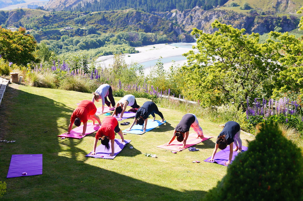 Yoga in paradise at an Aprivé Wellness wedding retreat