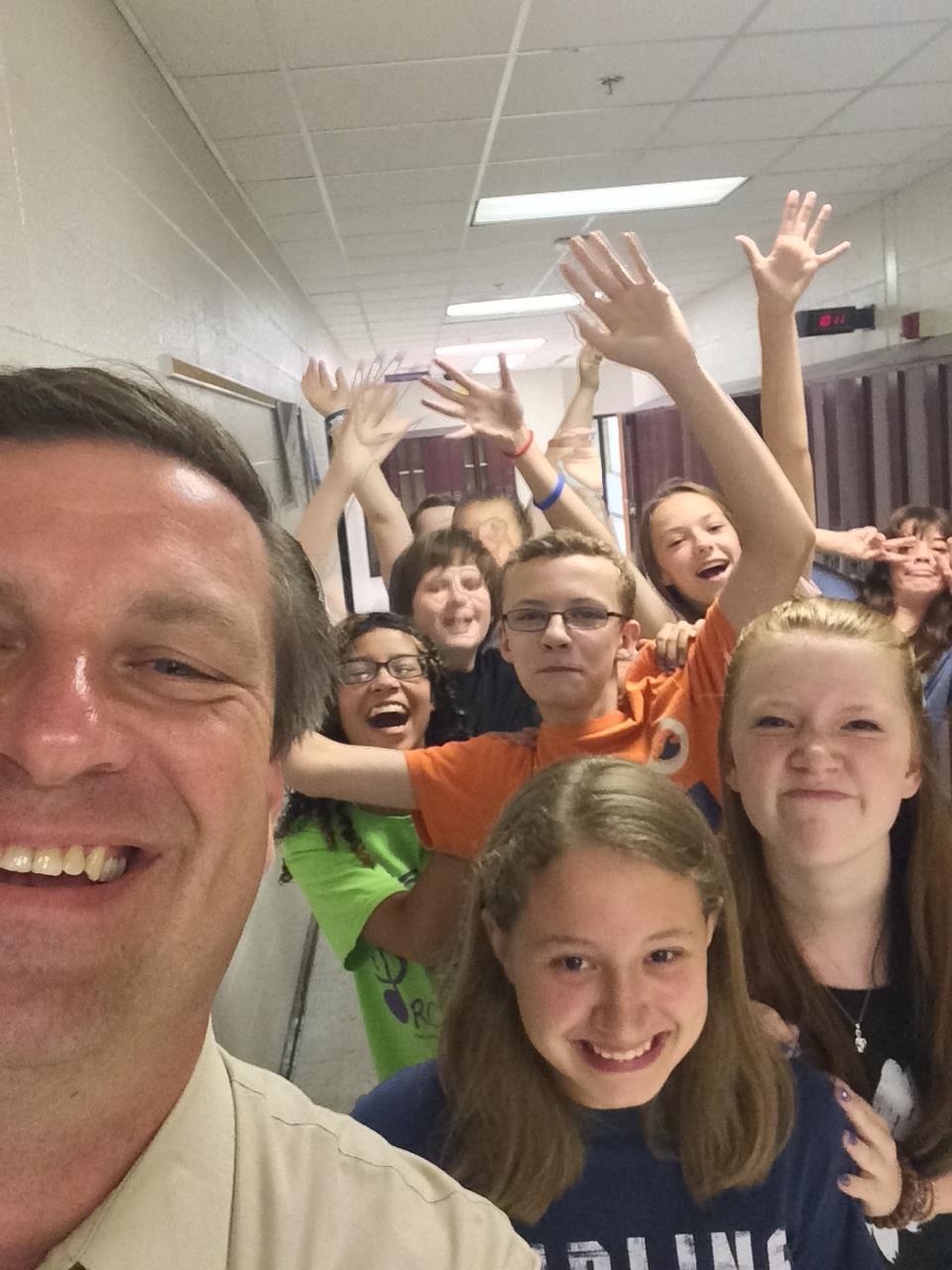 Photo provided by Tom Conway - Tom and his students celebrate their upcoming poetry slam.