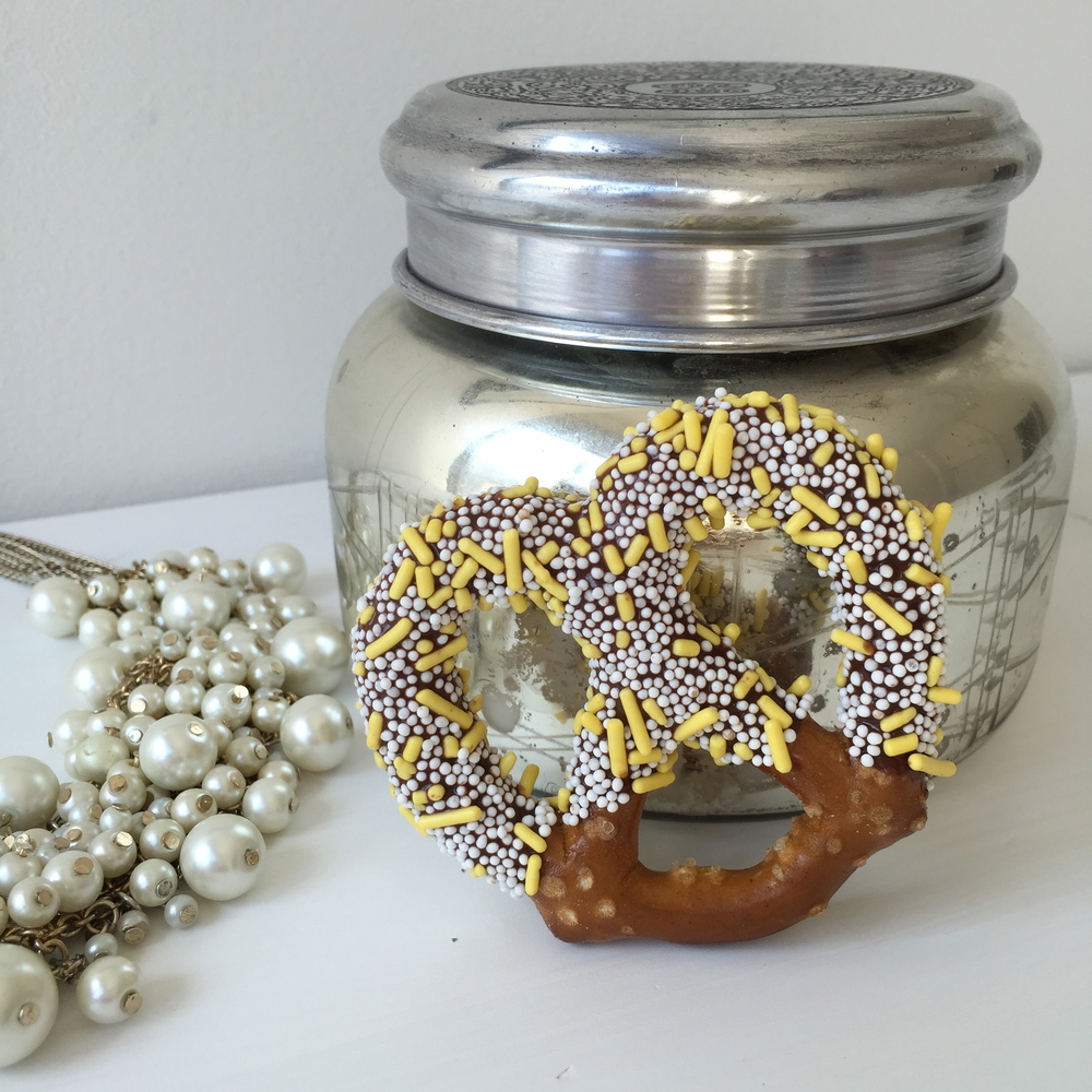 Dipped in dark chocolate infused with cappuccino flavoring; adorned with yellow sprinkles and white  nonpareils