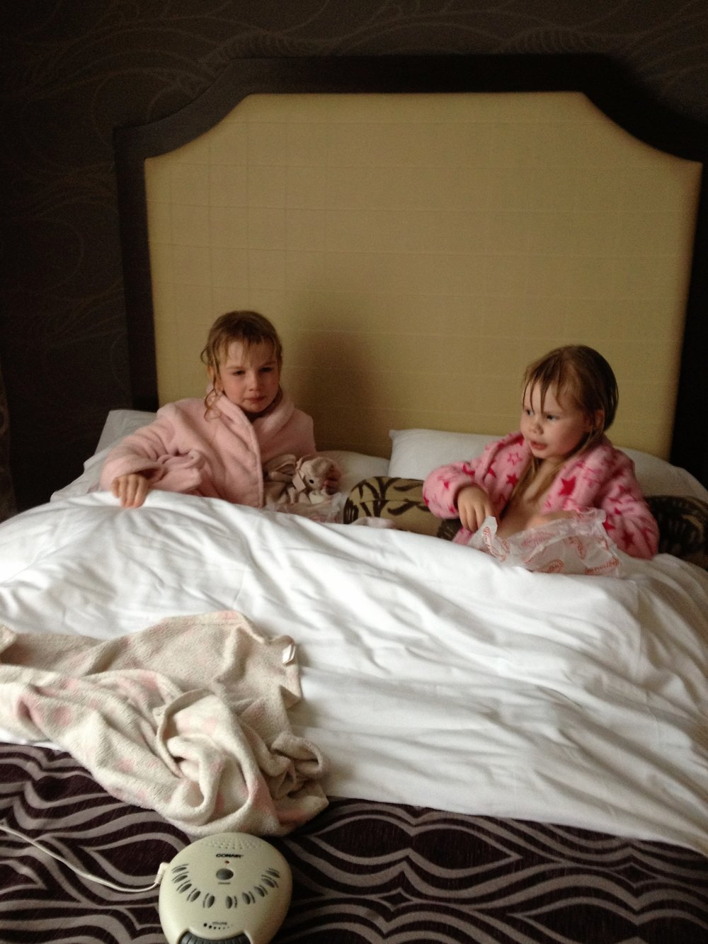 """Sadie and Stella enjoying a little """"post-swim"""" breakfast in bed! Hotel living at it's finest!"""