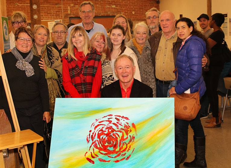 Councillor Rick Kerr (centre front) and The Rose, a collaborative painting created at the launch of The Cycle. Photo by Denise Wilkins
