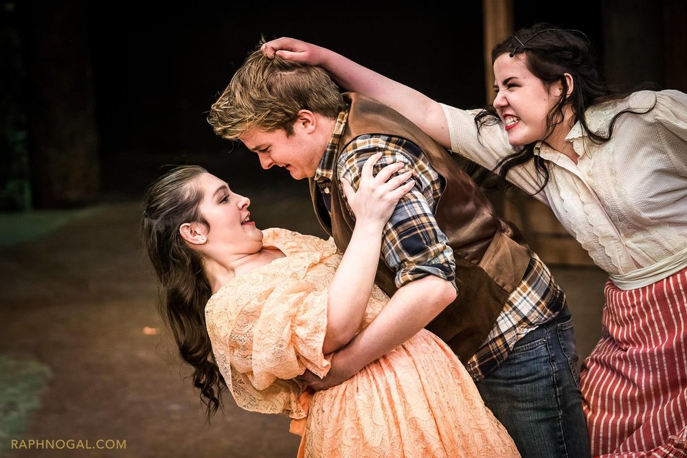 Left: Coral Benzie as Gertie, Liam Donovan as Will Parker and Laura Currie as Ado Annie. Photo by Raph Nogal Photography