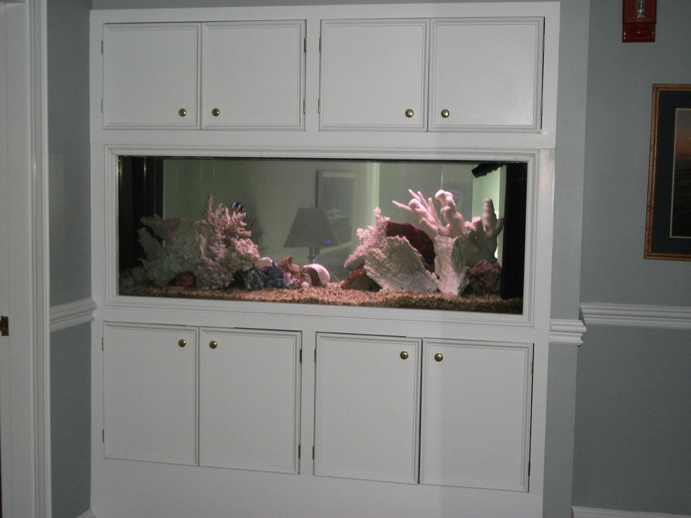 find quality aquarium furniture. we can build you an in wall aquarium or free standing our cabinetry is of the highest quality and be designed to match your existing cabinets find us find furniture