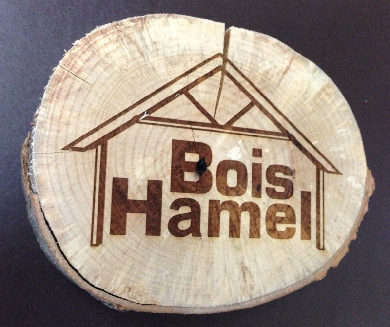 Light version of the Bois Hamel signature on a log