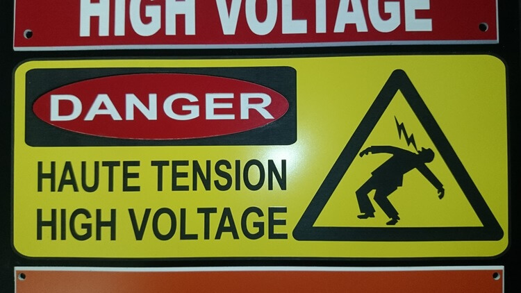 Warning signs for an electrical panel