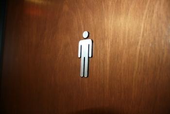 Sihlouette sur la porte des toilettes pour Homme