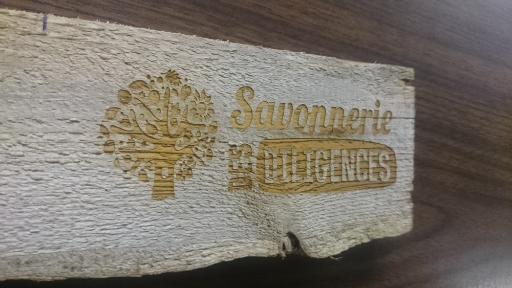 Wood plank with engraved logo