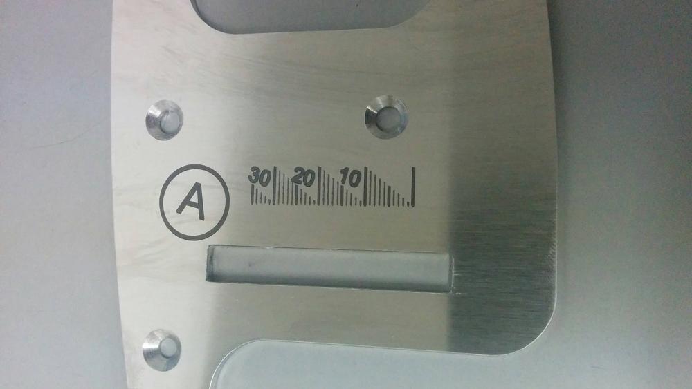 Guide avec mesures marqué au laser