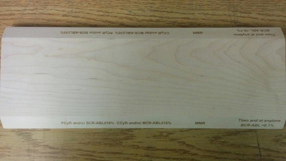 Planche de bois gravée au laser