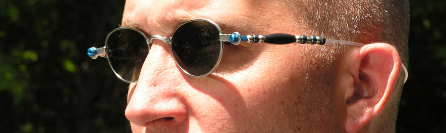"Here is a customized wire rimmed sunglasses unhinged and spokified! Buffalo horn beads are how we say say ""SpokeTribe""."