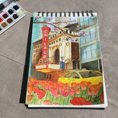 Ink and watercolor plein air painting of the Chicago Theater