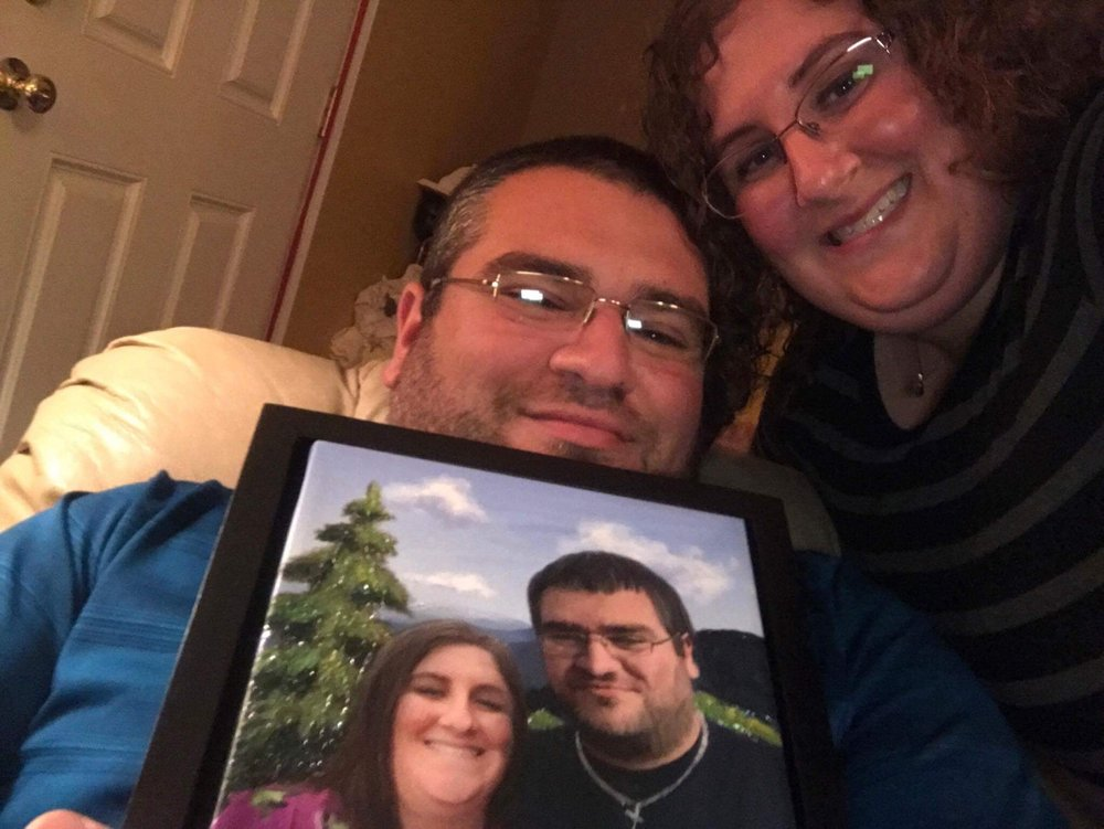 The happy couple with their custom portrait art!