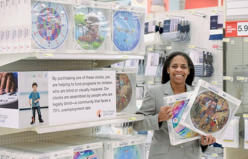 n a Wheaton Target store, Pam Tully, the chief operating officer for The Chicago Lighthouse, shows off a new collection of clocks made by employees who are blind or visually impaired.