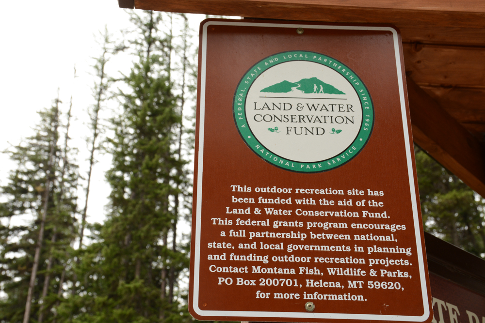 Sign at the Thompson Chain of Lakes State Park proclaiming the benefit of the Land and Water Conservation Fund.                                                                      Photo by Laura Lundquist