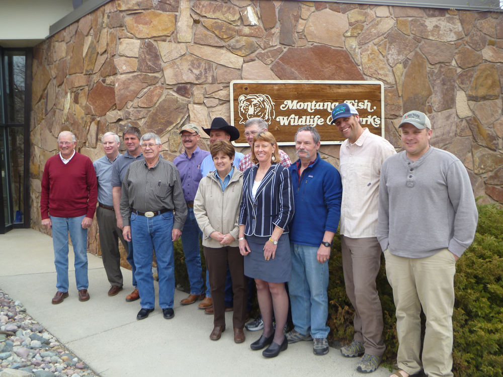 Facilitator Barb Beck (center in striped jacket) stands with the FWP Licensing Advisory Council in front of the FWP Headquarters building in April 2014. On Oct. 15, Beck was selected to be the new Region 5 Supervisor.          Photo by Laura Lundquist
