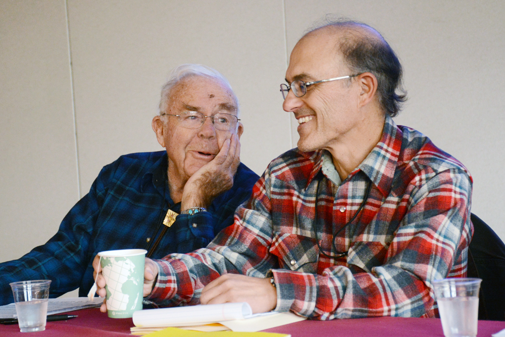 Stewart Brandborg, left, shares a moment on Thursday with George Nickas of Wilderness Watch prior to a discussion panel. The two men advocated for staying true to wilderness principles during the 2015 National Wilderness Workshop in Missoula.  Photo by Laura Lundquist