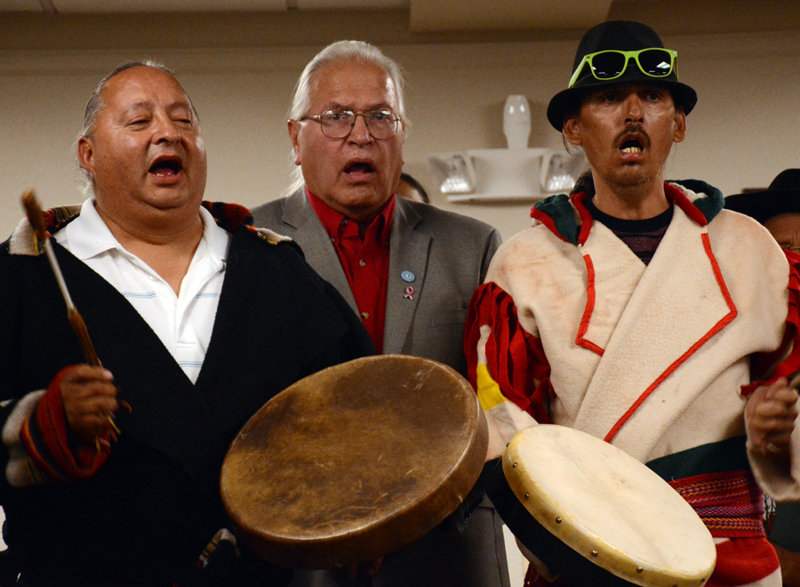 Blackfeet chairman Harry Barnes, middle, sings with members of the Blackfeet Nation at the hearing of the Advisory Council on Historic Preservation in Choteau in September. The Blackfeet oppose an oil and gas lease on spiritual ground in the Badger Two Medicine area of the northern Rocky Mountain Front.  Photo by Laura Lundquist