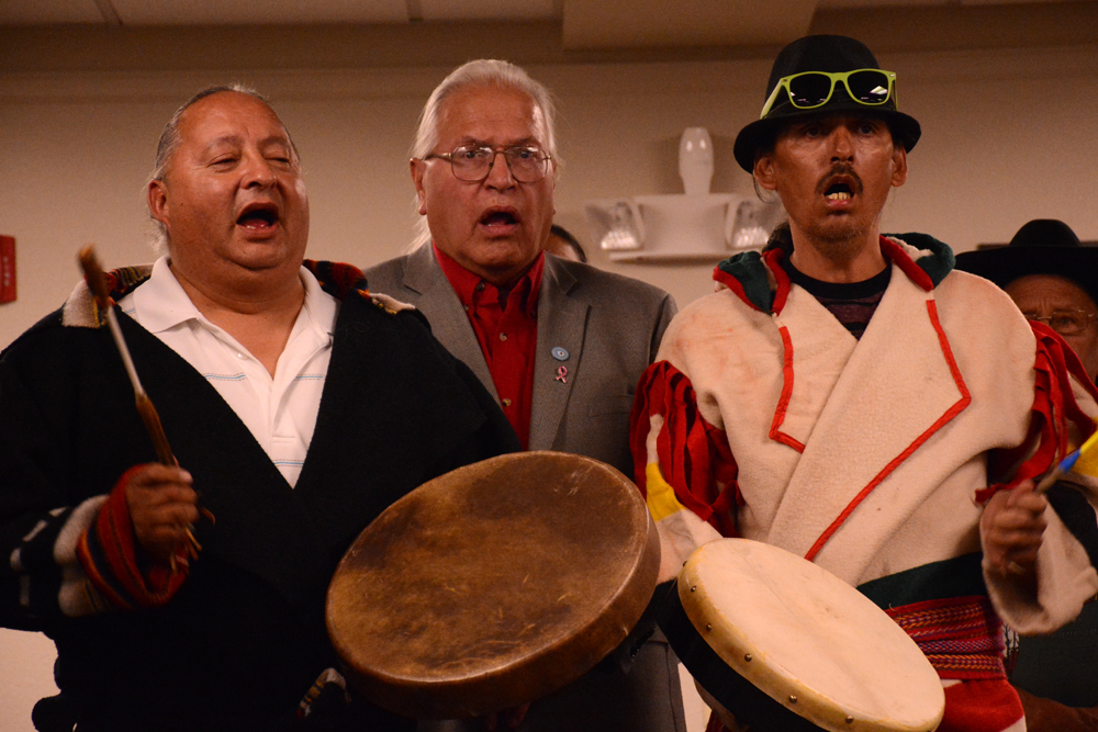 Blackfeet Tribal Business Council chairman Harry Barnes, center, joins Blackfeet singers in a song prior to the September 2015 meeting of the Advisory Council on Historic Preservation in Choteau.
