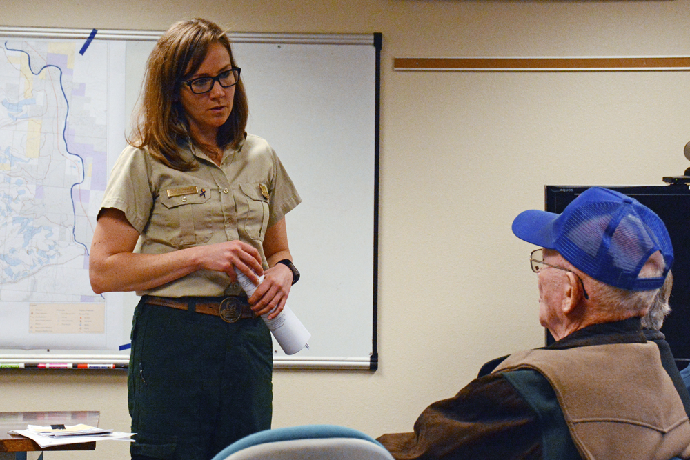 Ninemile District Ranger Erin Phelps listens to a logger's concerns during a public scoping meeting Tuesday on a proposal to salvage log parts of the Sunrise and Sheep Gap fires. Photo by Laura Lundquist.