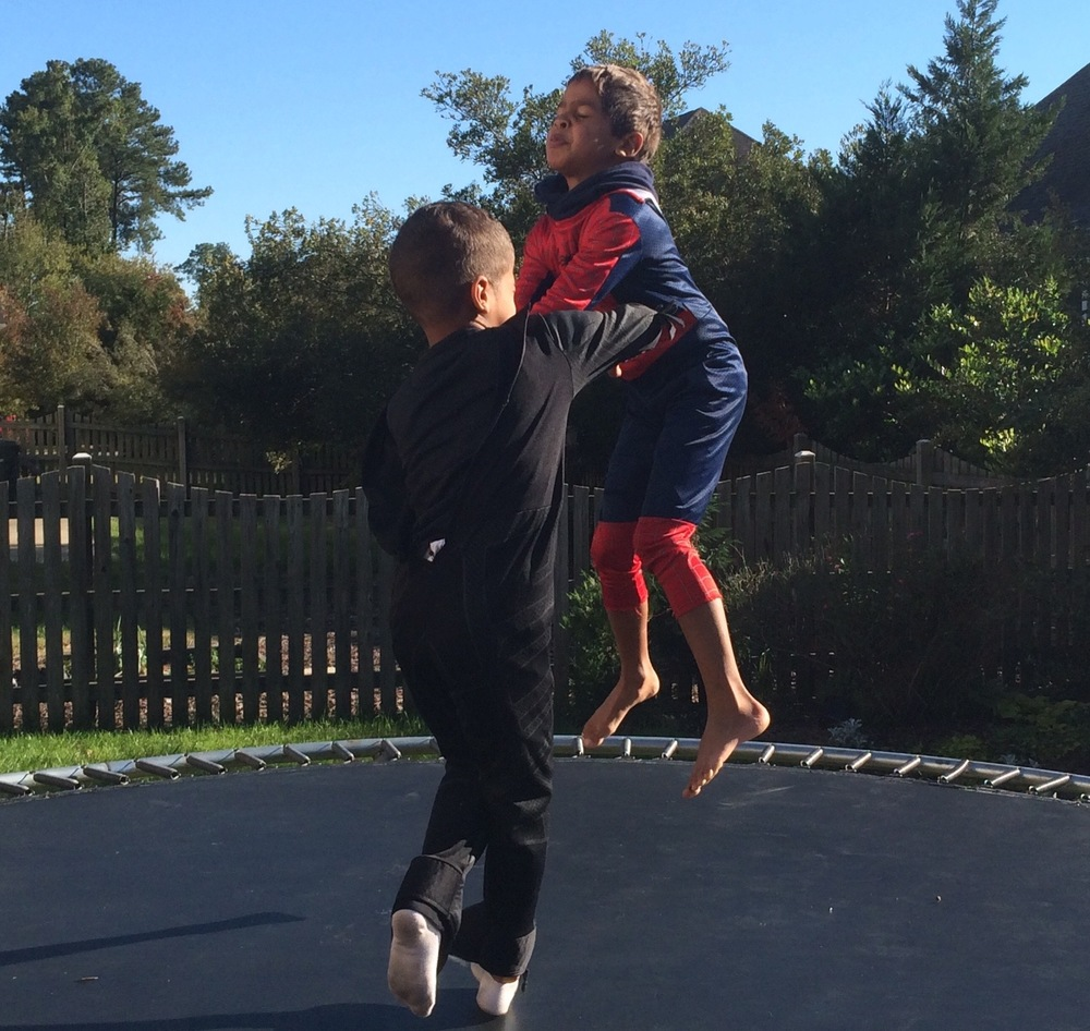 My twins' rendition of a Spiderman (Blaise) and Batman (Ezra) trampoline duel.