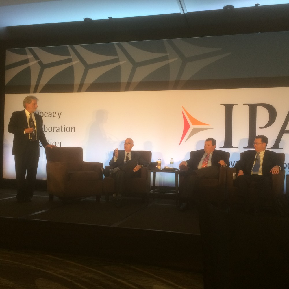 "Nick ""The Agility Doc"" Horney, Ph.D., (left) facilitating a panel discussion at the 2015 Investment Program Association conference."