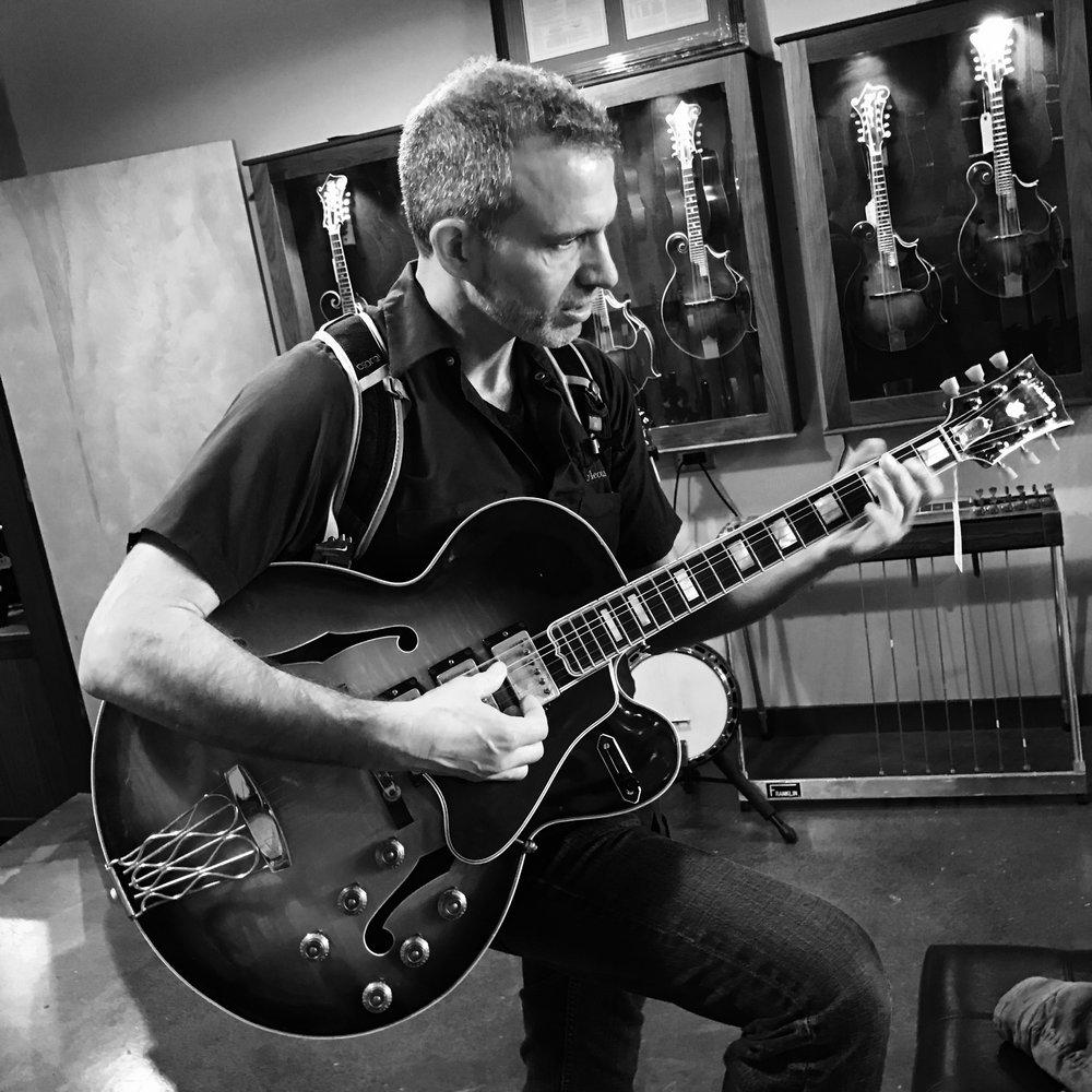 Dan Strauss - Singer, songwriter, guitarist and teacher.