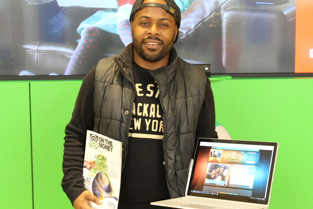 Ronnie with the 1st Edition On The Money Magazine and Microsoft's Surface Book!