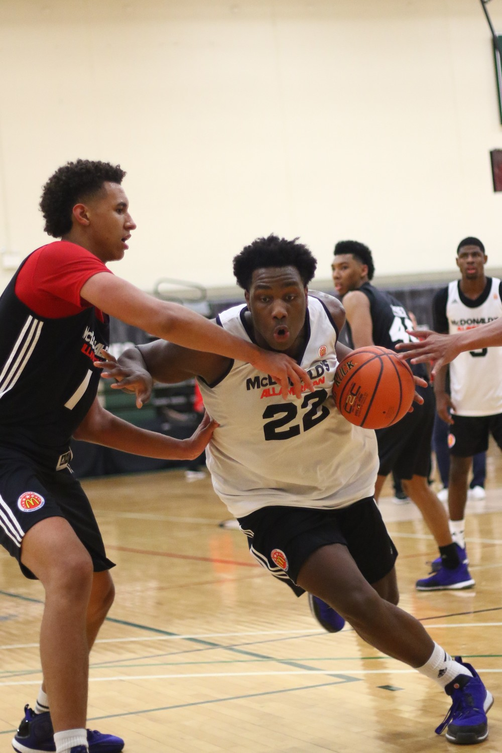 Caleb Swanigan drives on Chase Jeter at the 2015 McDonald's All-American game closed practice