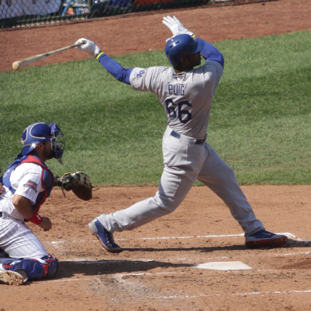 Yasiel Puig at bat during Clayton Kershaw's 20th victory in 2014