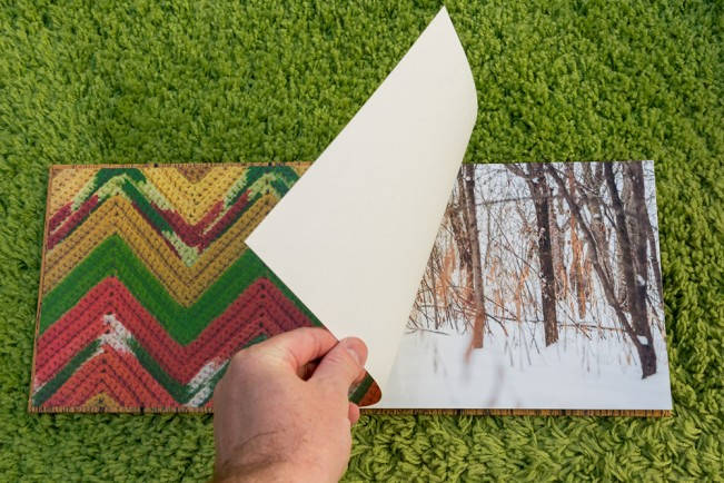 hand turning page of Northwoods Journals by Kurt Simonson, printed by the bigger dot