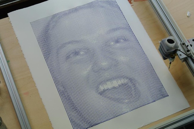 print of a woman's face in blue ink