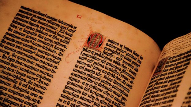 ancient book opened to show text